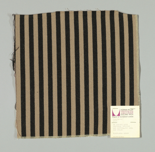 Warp-faced twill in vertical stripes of black and beige. Plain weave binding foundation has light brown warp and weft threads.