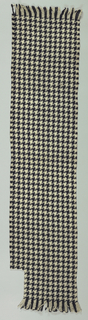 Scarf with a large scale black and white houndstooth check. No selvages.