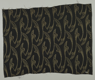 Sheer black crepe ground with design in gold metallic. Long slender leaves turning alternately up and down in an all-over repeating pattern.