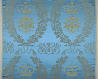 "Panel of damask with large scale design of oak leaves, rose and thistle, and crown; gold lurex pattern on blue satin ground. ""Queensway"""