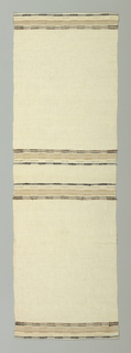 Long table mat in white with striped pattern ends and center in brown, black and metallic thread.
