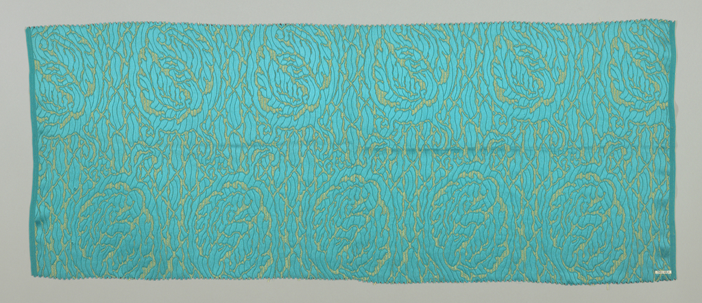 Bright blue-green ground with closely-spaced allover highly conventionalized floral medallion design in satin weave against a ground of plain weave combined with supplementary yellow weft.