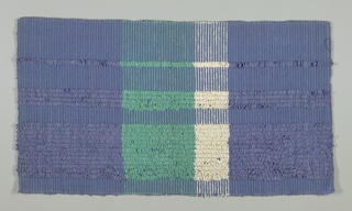 Deep purple-blue ground cloth with wefts beaten down to hide warps. Heavier wefts run in at quarter inch intervals and deeply looped in certain areas to form vertical stripes of varying widths. Broad bands of purple-blue stripes alternate with narrower bands of jade green and white.