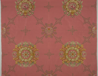 Floral medallions in multicolors connected by a squared diamond grid in gold. Background: rose. In the style of early 19th century  (Empire).