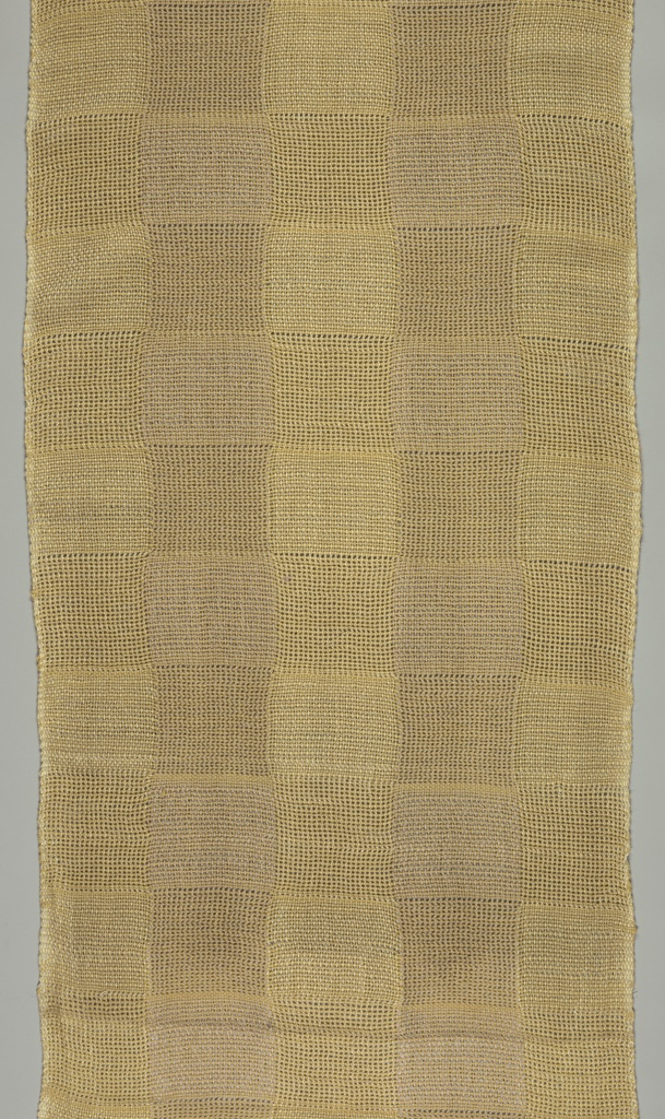 Checkerboard pattern of plain weave alternating with gauze weave in beige and tan.