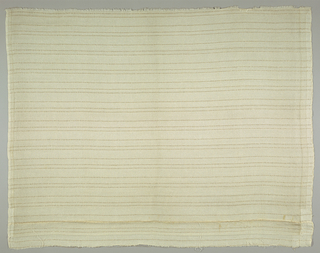 Section of a curtain hemmed on side sides. Fine and loosely woven with paired narrow gold strips in groups of three crossing it horizontally at one and a half inch intervals.