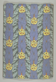 Light blue satin ground with damask sub-pattern of leaf blades. Dominant pattern is vertical columns of royal blue leaves with clusters of yellow and orange blossoms.