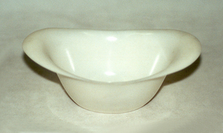 White plastic basin-shaped bowl with outturned handles.