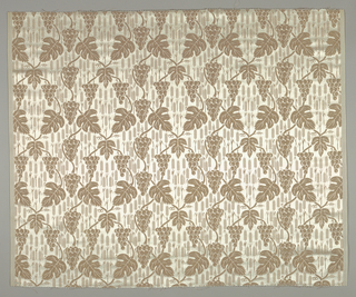 Length of fine white satin with symmetrical design in coppery gold of vine leaves and grapes on twining stems; wheat heads filling ground. Two wide cloth selvages with heavy rayon warps.