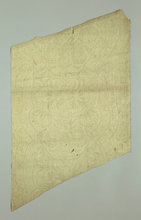Louis XIV. Symmetrical design of big bouquets in lobed framing band decorated with various flowers and diapered areas. Various ground diapers suggesting lace patterns. Stamped and glazed on fine white wool ground.