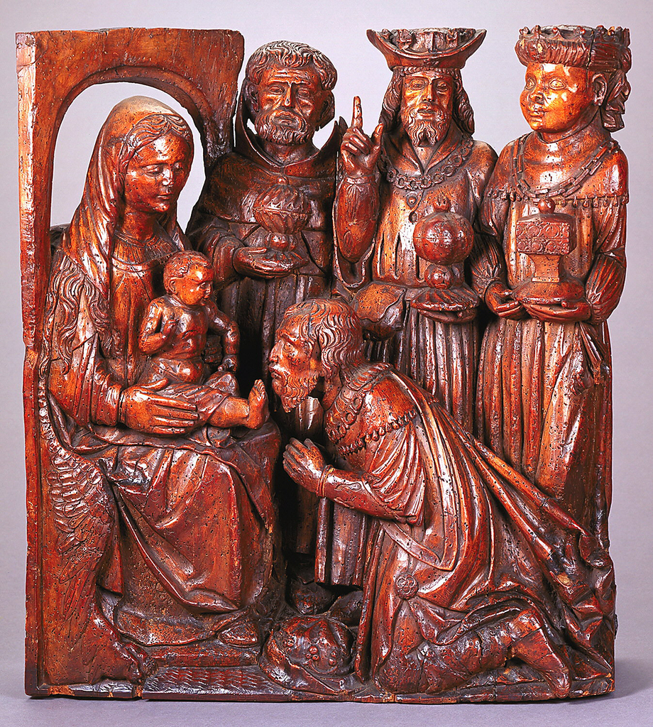 Virgin seated at left, with child on her knee. One of the kings kneeling before the child, three figures ranged across back of group.