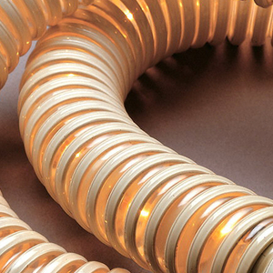 Plastic PVC piping curled into a loop and lit from within.