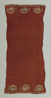 Towel of dark red cotton in a crêpe weave. Ends embroidered in simple detached flower sprays of blossoms surmounted by curving leaf form. Center of flower, drawn and embroidered in gold; outlined in gold. Simple border design and buttonhole edge.