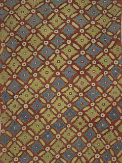 On a loosely woven red tabby ground, blue, pale green, white and buff silks in bukhara couching stitch form an all-over diagonal trellis pattern enclosing large diamond forms with leaf outlines in whose centers are reserved small squares. White discs connect the arms of the trellis.