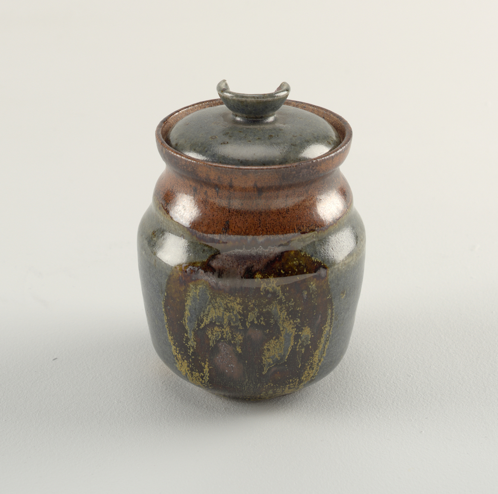 (a) Jar with molded shoulder. Bluish-gray glaze with glossy iron-brown decoration on two sides, and iron-red neck; (b) slightly domed lid with dish-shaped knob, glazed bluish-gray.