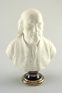 A bust portrait of Benjamin Franklin in biscuit porcelain on a gilded underglaze-blue waisted socle.