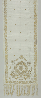 Sheer white voile scarf embroidery in tambour work with gold. Design of floral motifs, star and crescent and conventionalized Arabic script. Worn with harem costume.