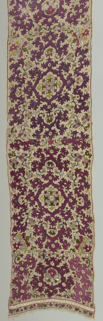 Small hanging or shawl of fine, loosely woven linen, embroidered in silk in blue, violet, red, olive green, pink and white. Design symmetrically arranged, of stylized plants with spiky, angular outlines. At ends, narrow border of white embroidery, fringe. Pieced in center.