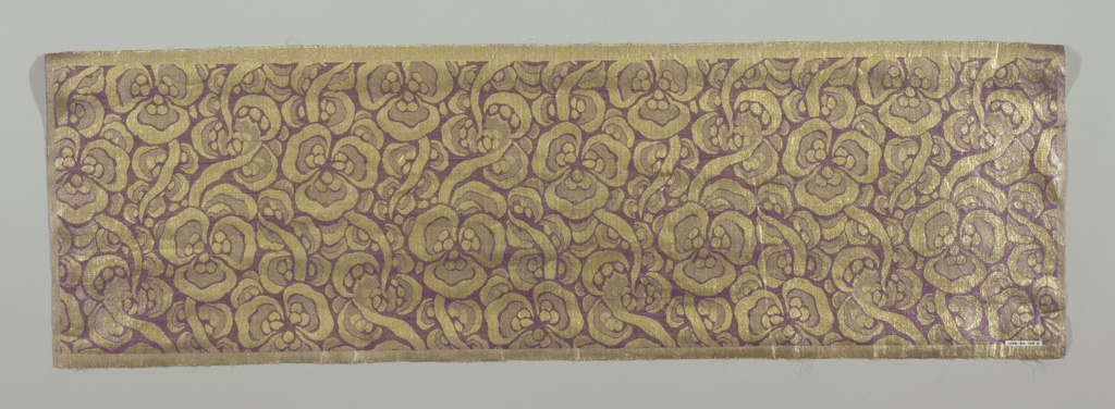 A tightly-arranged meandering gold ribbon makes a pattern of bow-shapes and knot clusters on a purple foundation.