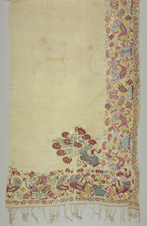 Horizontal panel with embroidered border on three sides consisting of two repeated but not quite symmetrical units, one a plant with tulip blossoms and the other two peacocks facing an urn of flowers.