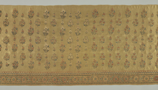 Wide border of tan-colored silk embroidered in a floral pattern and detached allover floral sprigs. Colors are faded and now are dull red, blue and gold.