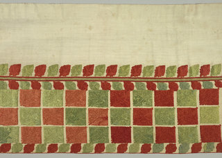 Wide valance of linen in two parts, joined horizontally by a narrow band of ribbon. Lower half is embroidered with horizontal rows of stylized leaves, almost square in form, alternately red and green, with borders of smaller leaves. The upper section has one border of the same leaf design.