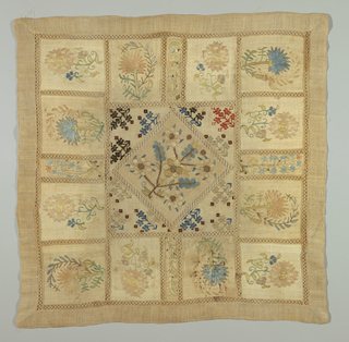 Square made up from small squares of embroidery joined with insertions of torchon lace. Large center square has stylized sprig repeat.