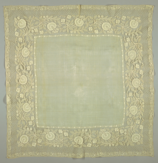 Handkerchief in piña cloth edged with a wide border, embroidered in cotton in drawnwork in large scale floral sprays.