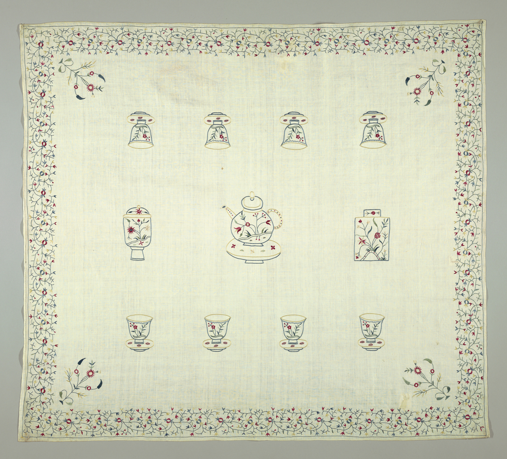 White cloth embroidered with a design of a tea pot, a tea caddy, another container and eight cups without handles in two blues, two greens, red, pink and yellow. A 2 1/4 inch floral border in the same colors on all four sides. A flowering plant in the same colors rises diagonally from each corner.