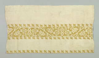 a: White linen embroidered in leaf design arranged in a wide and a narrow border.