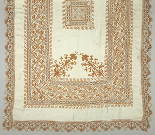 "Table cover or ""paño de ofrenda"" of white hand woven linen embroidered in light brown linen thread. Cutwork squares and borders are worked in white and brown thread. Traditional stylized lily at corners of center section. Wide border with diamond-shaped pattern stag, ""bicho"" and cut-work squares. Wide edging of crocheted lace in brown and white thread."