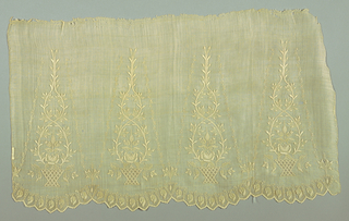 Rectangular piece of fabric for the sleeve of a blouse embroidered in a design of a plant in a basket alternating with leaf and scroll motif. One scalloped edge.