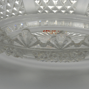 Elliptical, deeply notched rim; sides paneled with diamond diapering. On low foot with sunburst pattern.