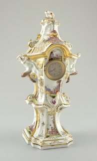 Lantern-shaped clock case raising from tall concave sockle on roughly square base. Two satyrs seated on scrolls support arched cornice above which a ribbed, scrolled and wrinkled top raises, crowned by a cat. Clock in center framed in metal and covered with glass. Polychrome and gold chinoiserie scenes and scrollwork.
