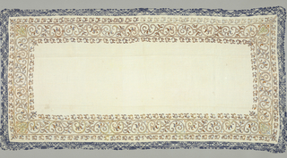 Rectangular linen cover having a plain center with an embroidered border on four sides in light and shades of orange. Embroidered design is comprised of two elements: a continuous leafy scroll with heart-like devices in each corner, and narrow guard on each side of isolated leaf or vine-like elements with elaborate finials at each corner. A continuous trim of bobbin lace in ivory and deep blue is sewn to the outer edge, and is in the form of a randa.