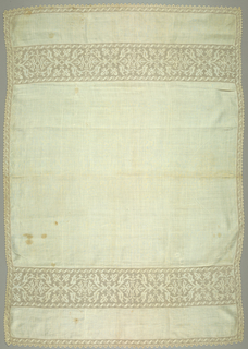 Table cover of fine white linen ornamented with white bands across the ends and sides. The pattern is reserved in the white linen. Edging of narrow pointed needle lace.