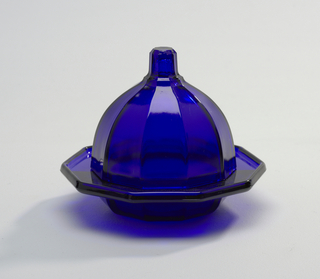 Cobalt blue glass dish on foot in octagonal shape with 8-sided bell-shaped cover with knop.