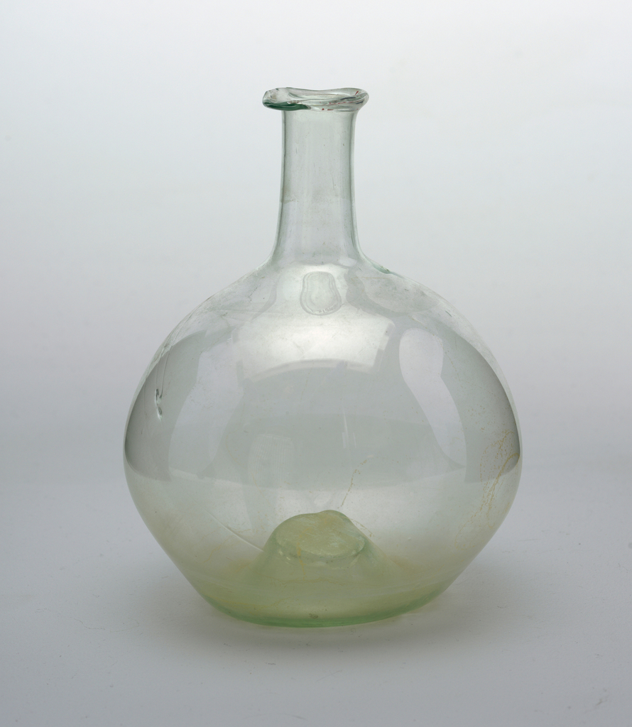 Light green glass bottle, globular body with tubular neck and flaring turned-over lip; pontil mark on body.