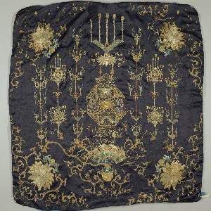 Embroidered panel, possibly a table frontal. Motifs include elaborate lanterns, flowers in each corner and scrolling lines.