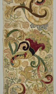 Panel of buckram with ground worked solidly in ivory silk. Design of a horn of plenty, great swinging branches and flowers worked in multicolored thread.