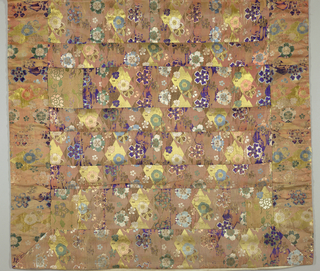 """Priest's robe of deep apricot-colored satin brocaded in brilliant flower design in blues, greens, yellow, purple, white, and gilded paper. The technique is known as """"kara ori,"""" a brocading with threads floated on the surface. Made in squares and pieces to simulate patches for a Buddhist priest's robe."""
