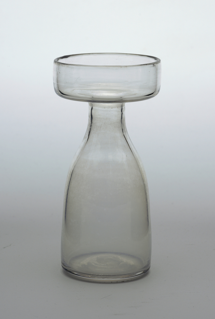 Ovoid body tapers to thin neck, wide flat lip with turned up rim. Hyacinth