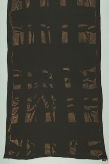Black fabric with random rust brown shapes.