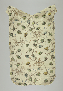 All-over embroidery of green leaves on metallic stems. The piece may have been made up as a chausable but that was not its first use as the design on the fabric is at right angles to the lines of a chausable.