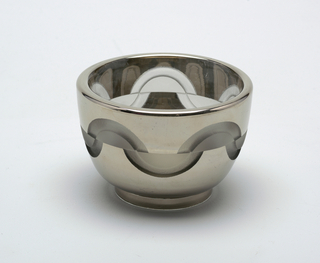 Deep circular bowl of silver-toned glass encircled by acid-etched half-circles, alternating up and down; low disk foot.