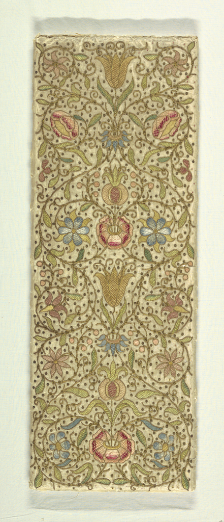 A vertical panel with a design of conventionalized flowers and leaves with scrolling stems worked in green, pink, red, yellow and blue with gilt cord and paillettes.