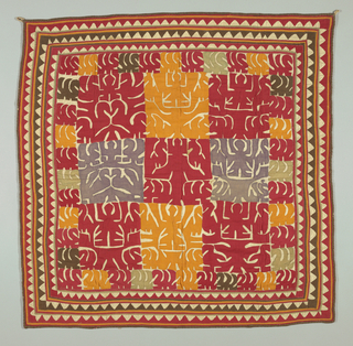 Square cover patterned by sewing down shapes of brightly colored cotton. Field has a square repeat of a tree, birds and a human figure. Inner border a repeat of leaf shapes. Outer border has a repeat of triangles.