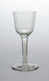 Goblet of clear glass with ogee-shaped bowl, opaque white lace-twist straight stem and plain foot.