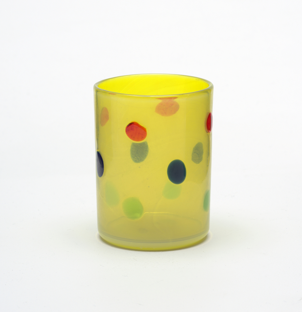 Yellow glass, red, blue, and green dots