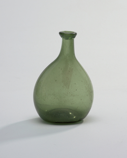 Asymmetrical green flask, with slightly tapering neck and irregular rim.